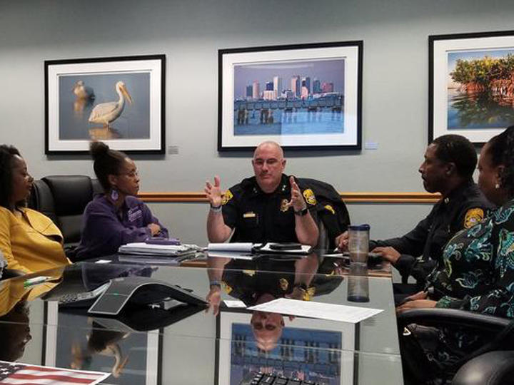 Chief Brian Dugan meets with members of the Mayor's African American Advisory Council on March 9.