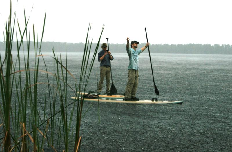 The heavens open on expedition members Carlton Ward Jr., left, and Joe Guthrie