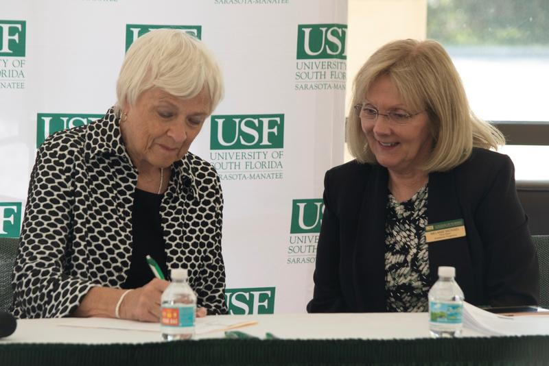Dr. Karen Holbrook, Regional Chancellor of USF Sarasota-Manatee; Dr. Melanie Michael, Vice Dean of Academic Programs at USF Heath College of Nursing, sign an agreement Thursday bringing the Nursing program to USFSM.