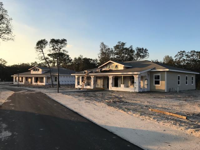 The seven houses were in various stages of construction as of February 2018, when this photo was taken.