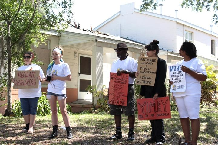 Housing adovcates gathered outside the vacant North Boulevard Homes on Saturday to demand more funding for afforable housing in Tampa.
