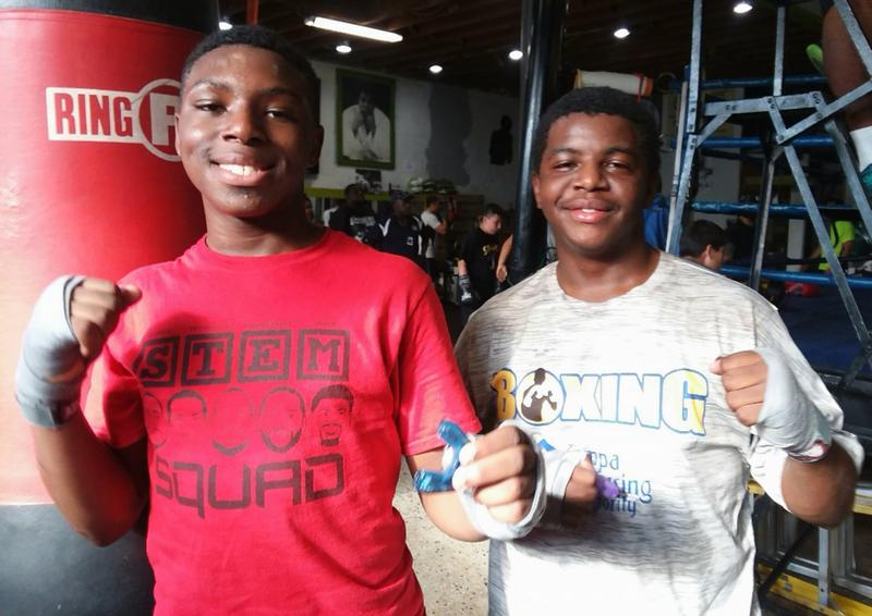 Corey Anthony Jr., and Stephon Mosley, both 17, at Legends Boxing Club in Tampa before a training session with coaches from The Tampa Police Athletic League.