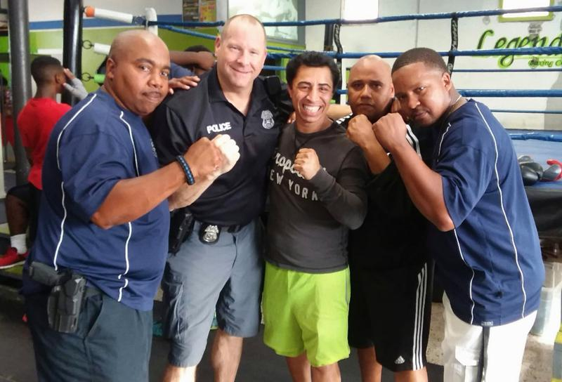 Officers Mike Gambrell, Dave Hancock, Legends Boxing Club owner,  Francisco Arreola, Officers Dennis Small, and Azariah Israel.