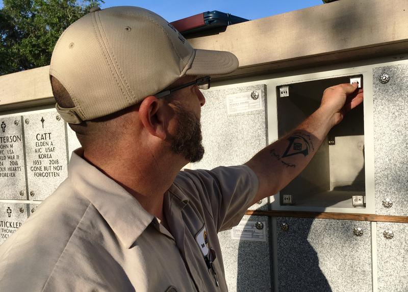 Bay Pines Cemetery worker Terry Clark prepares a niche in Columbarium B for the remains of Clifford Bisek, an Army and Navy veteran.