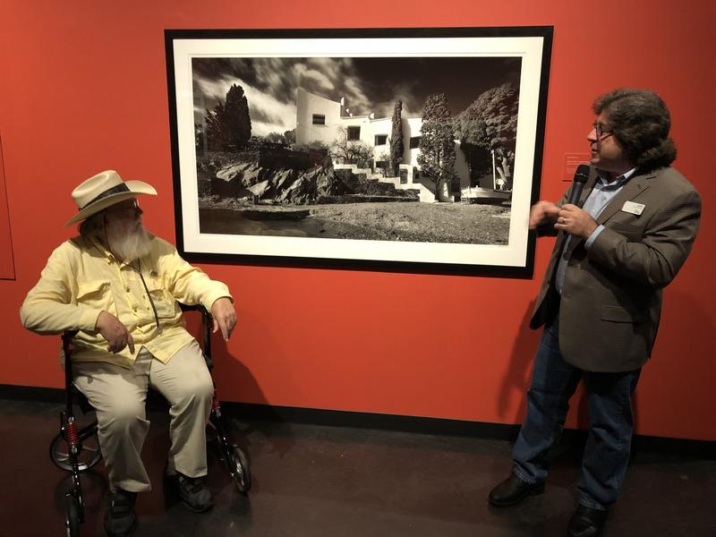 Landscape photographer Clyde Butcher, left, and Dali Museum Curator Peter Tush, right, show off a photo of Dali's home.