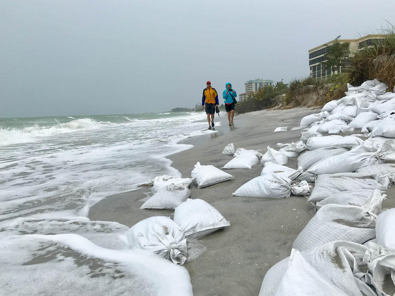 Tom Barwin (left) and Florida Department of Environmental Protection representative Kelly Cramer inspect Lido Beach following Subtropical Storm Alberto in late May.