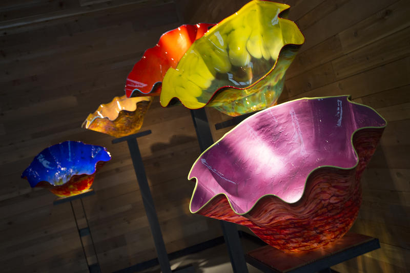 Now situated in its new building across the street from the hot shop, the Chihuly Collection boasts icicle-like chandeliers, colorful orbs that appear to be floating on water and a garden of glass flowers and reeds.