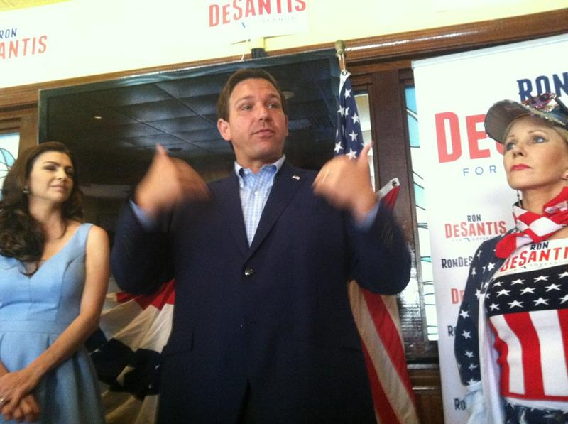 Ron DeSantis and his wife, Casey, left, campaign at Tiffany's Restaurant
