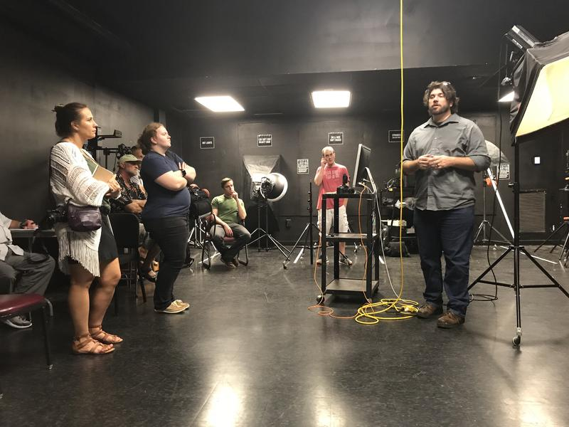 Jim Reiman (right) introduces different lighting techniques to Jayme Williams (far left) and the rest of the class.