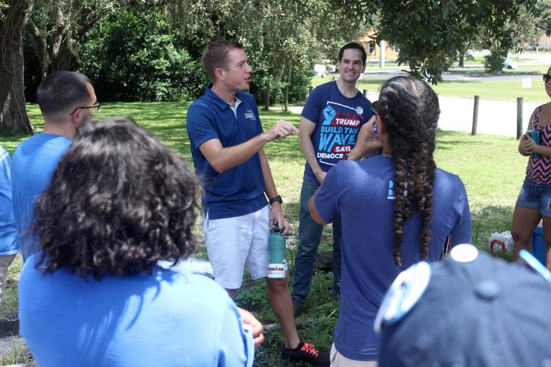 Andrew Learned, a Democratic candidate for congressional district 15, speaks with volunteers as they prepared to canvass in Temple Terrace on Saturday.