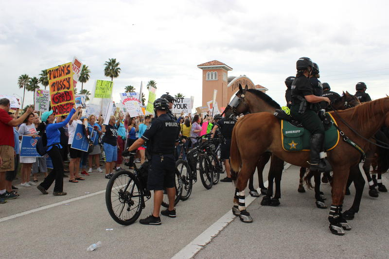 Law enforcement officers on bicycles and horses kept protesters and supporters separated.