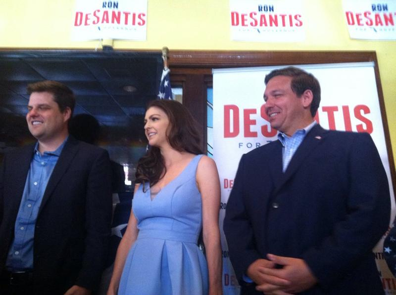 Rep. Matt Gaetz, left, with Ron DeSantis and his wife