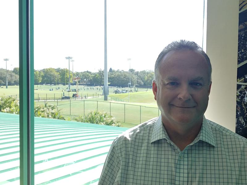 New USF Vice President of Athletics Michael Kelly stands in his office on the Tampa campus Tuesday while the football team practices outside.