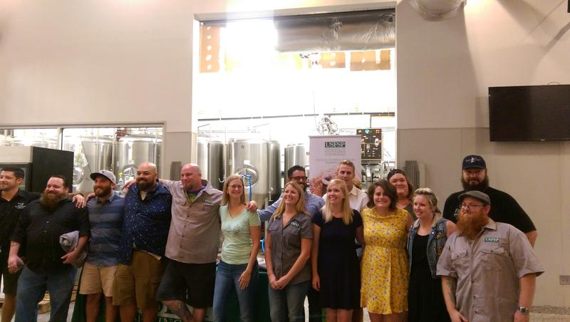 Johnnie Levin (center, light green shirt) was one of 19 graduates from the USF St. Pete's Brewing Arts' sixth class.