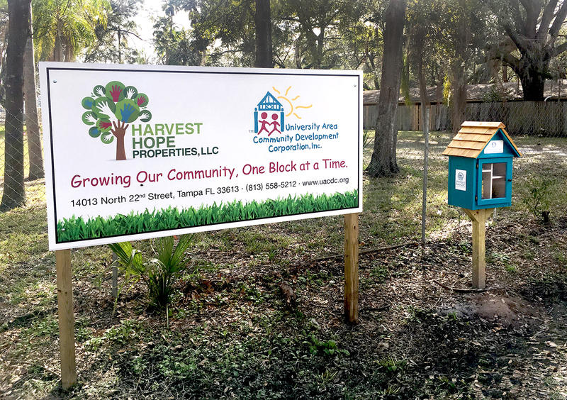 The UACDC puts up a Harvest Hope sign whenever they acquire a new property to let residents know that change is coming.