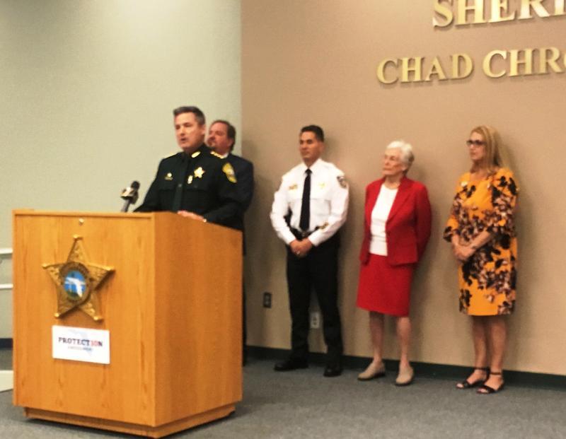Citrus County Sheriff Mike Prendergast speaks alongside Hillsborough Sheriff Chad Chronister and Hillsborough Clerk of Courts Pat Frank, in red
