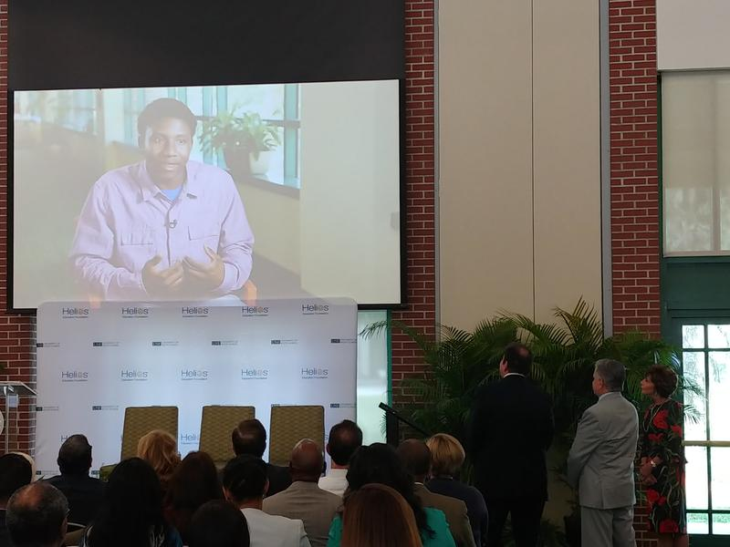 USF and Helios Education Foundation officials watch a video featuring scholarship recipients at speaks at a ceremony announcing the Helios grant at a ceremony on USF's Tampa campus Aug. 30.