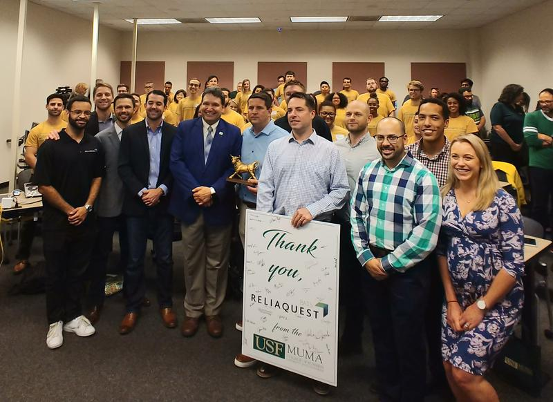 Lab students pose with officials from the USF Muma College of Business and ReliaQuest