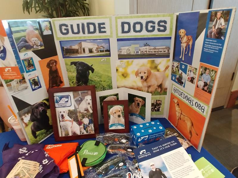 The new Puppy Raisers Club at USF Tampa recruited potential volunteers at a campus volunteer fair in September.