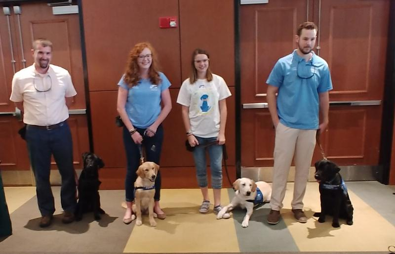 Anja with trainer Brian Cullum, Finley and Watson, Marvin and Cianna Cilenti and Sadie with USF grad student Zac Giparas.
