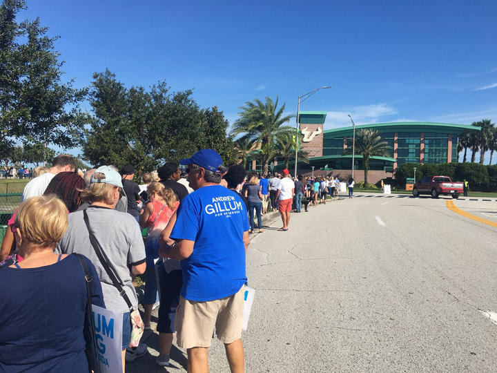 A crowd lines up to get into a rally for Democratic candidates at the University of South Florida.