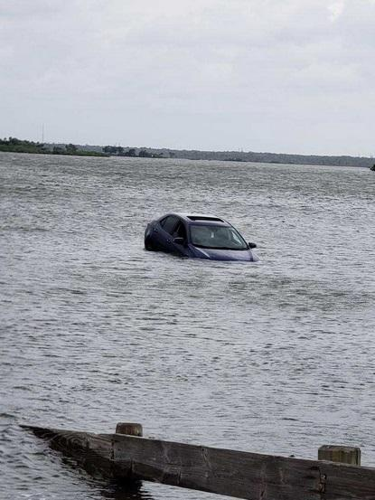 Citrus Sheriff's Office says a car parked in front of a boat ramp at Fort Island Beach in Crystal River was washed into the bay by waves from Hurricane Michael Wednesday afternoon.