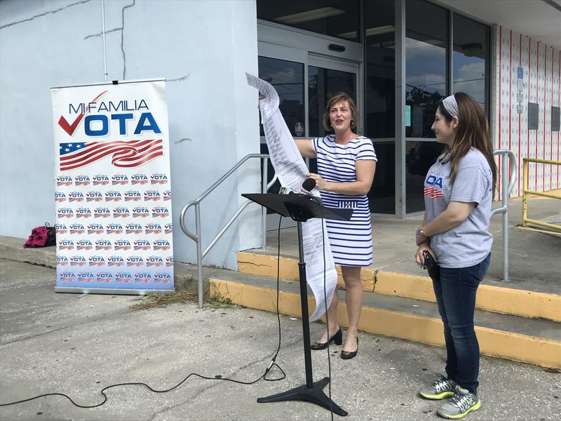 Tampa Congresswoman Kathy Castor (left ) and Nancy Batista Florida State Director of Mi Familia Vota (right) showing the lengthy ballot and explaining early voting by mail.