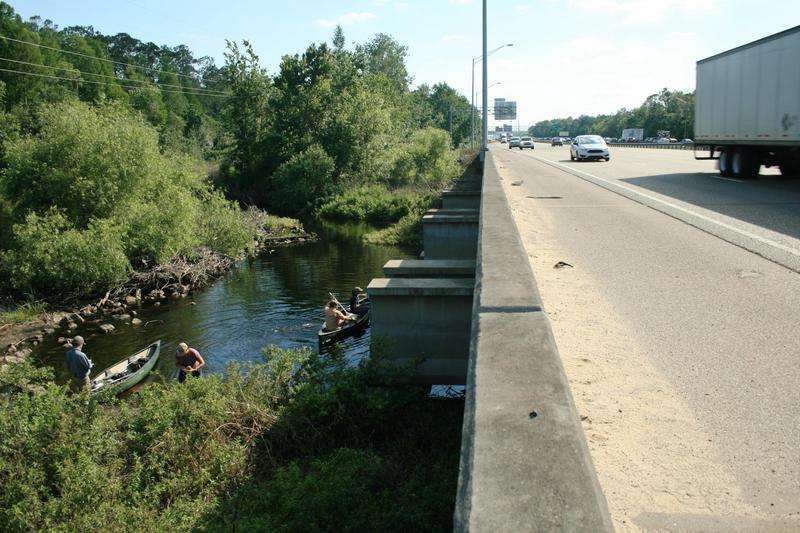 Members of the Florida Wildlife Corridor Expedition paddle along Reedy Creek south of Disney World, under Interstate 4, earlier this year.