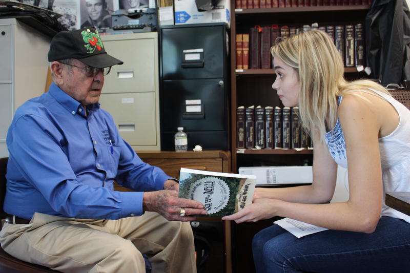 "Plant City farmer Alvin Futch discusses his book, ""Saw Mill,"" with USF student journalist Molly Urnek."