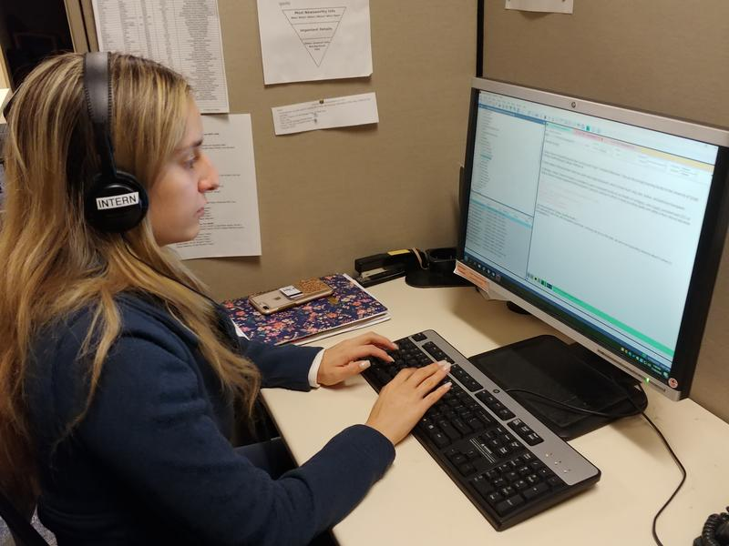 WUSF/USF Zimmerman School digital news intern Hannah Yechivi works on a story.