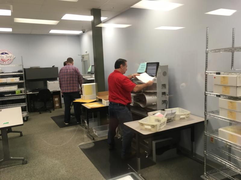 Tabulation machine counting ballots in Hillsborough County's recount room on Nov. 10, 2018.
