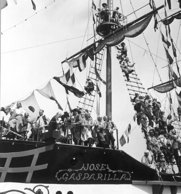 Look closely and you can spot pirates on the Jose Gasparilla II in 1959 enjoying some adult beverages as they invade the city.