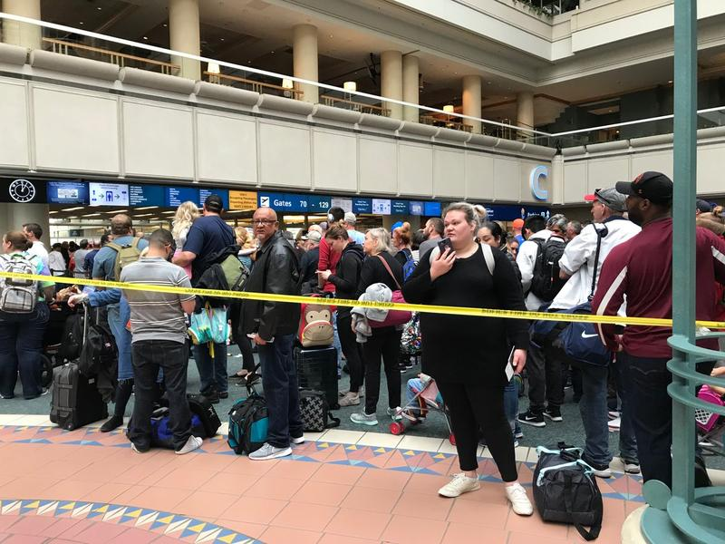 Passengers at Orlando International Airport waited hours on Saturday after the apparent suicide of a TSA worker.