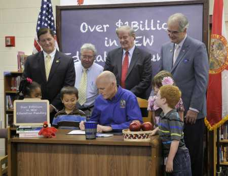 Gov. Rick Scott signs the state budget Tuesday at Cunningham Creek Elementary School in Fruit Cove