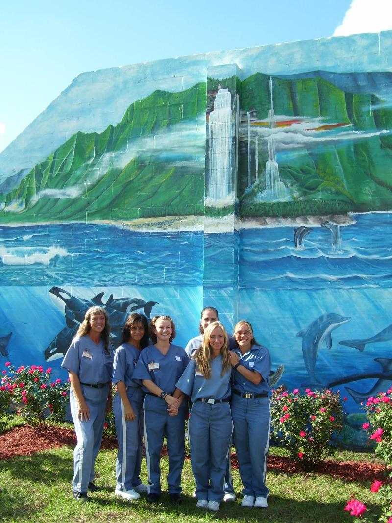 HCI meditation rose garden and mural painted by the inmates in this photo.