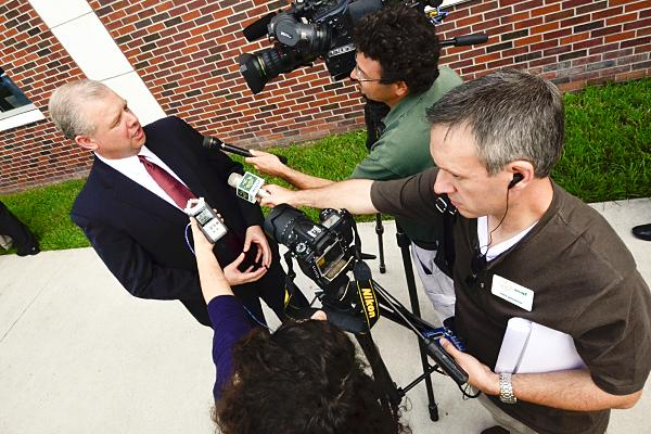 Reporters, including WUSF's Mark Schreiner (r with microphone), interview John Harding, President/CEO of Florida Hospital Tampa Bay Division