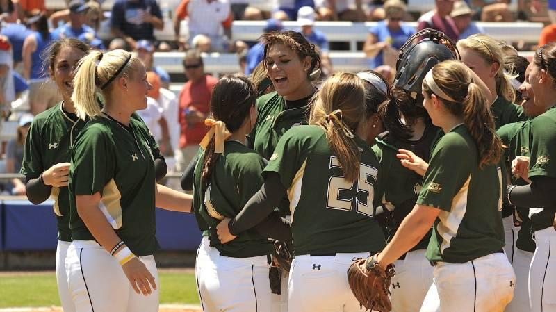 USF softball, led by USA Softball Player of the Year finalist, soph. Sara Nevins (center), celebrate Sunday's win