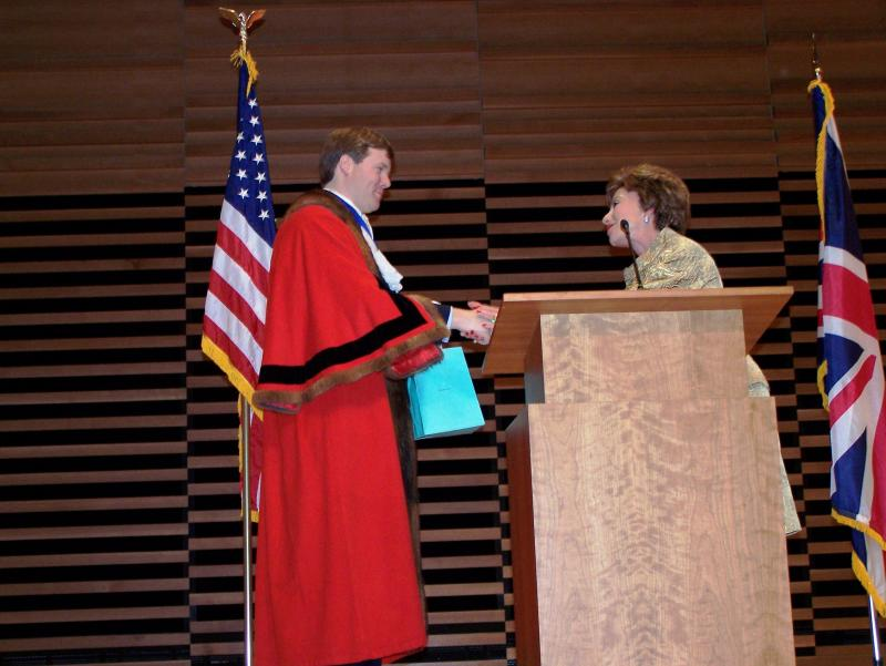 Former Lord Mayor of the City of Westminster, Duncan Sandys, receives a gift from USF President, Dr. Judy Genshaft