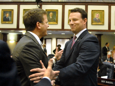 Rep. Will Weatherford shakes hands with then-Rep. Carlos Lopez-Cantera