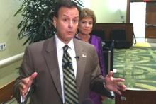John Ramil, President of USF Board of Trustees, addresses reporters with USF President Judy Genshaft, in March 2012