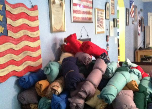 Another stack of pillows waiting to be transported to Tallahassee for the Homeless Veterans Stand Down this weekend.