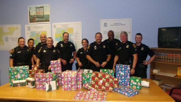 Members of Tampa Police Squad 204, who, along with Tampa Police dispatchers, bought new gifts to replace the ones a burglar took from a local family.