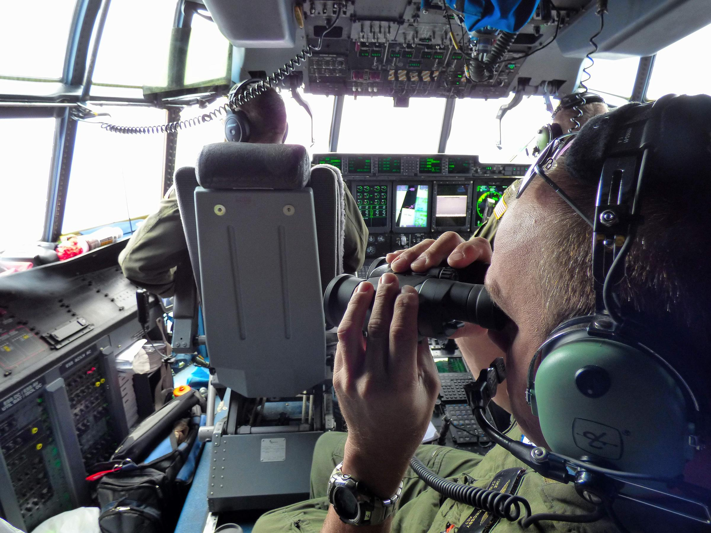 coast guard search for missing teen boaters active and open petty officer 1st class mike crosby right scans the surface of the atlantic ocean