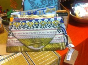A women's clutch is on display at the Amani warehouse on South Willow Street.