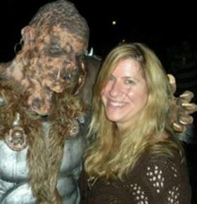 Jennifer Nicholas, the head of Atlanta's Zombie Outbreak Response Team, poses here with a monster.