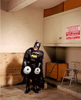 Gregg Segal's shot of Batman lifting weights