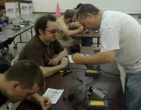 Jeff Johnson providing individual instruction at Chat*Lab's soldering workshop
