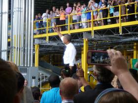 President Obama waves to the crowd at the Amazon Fulfillment Center in Chattanooga, TN.