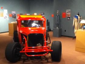 Photographs, a trophy, a racer's uniform and a restored hot rod are part of the Museum Center's dirt-track exhibit.