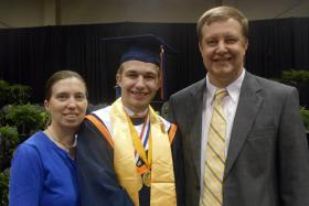 2014 Georgia Cyber Academy Salutatorian Eddie Sunder with his parents.